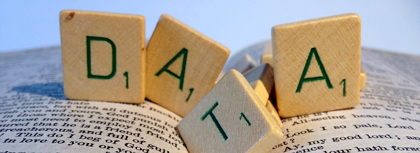 photo of book with scrabble letters spelling 'data'