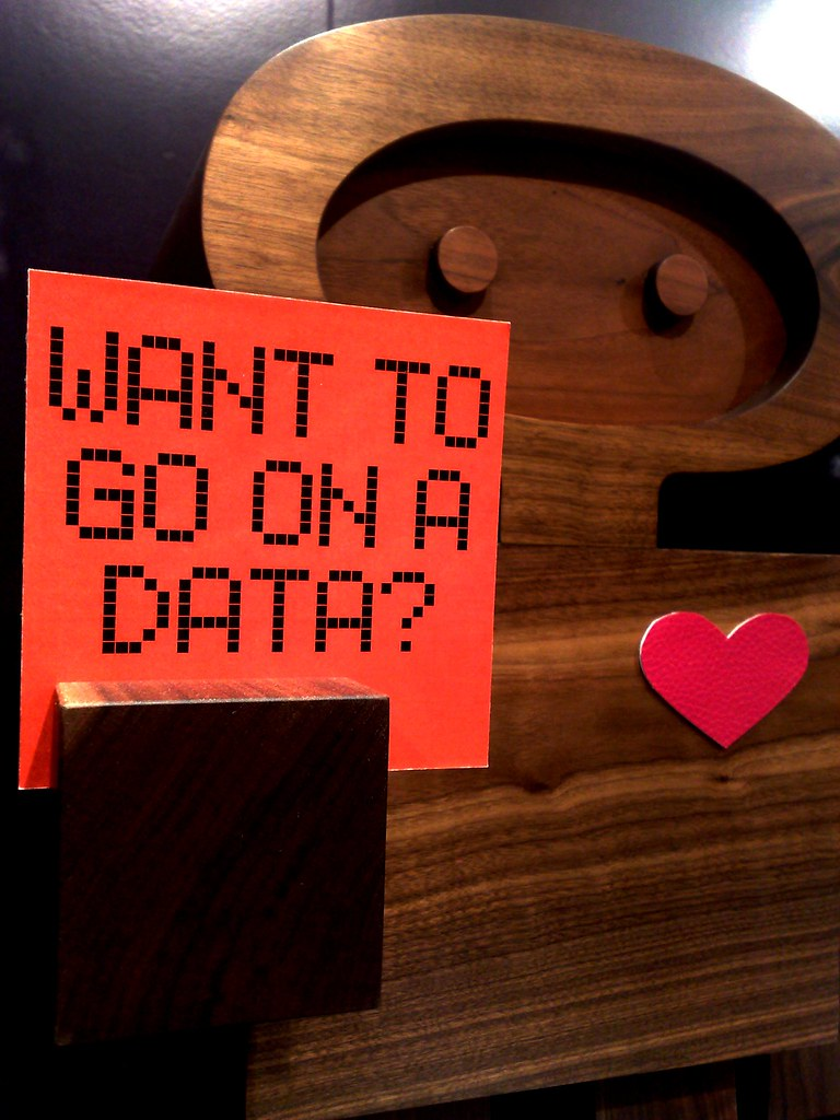 """wooden robot sculpture holding sign: """"Want to go on a data?"""" [haha]"""