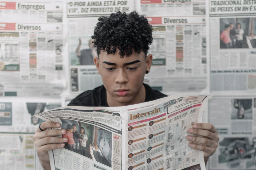 Young man reading news