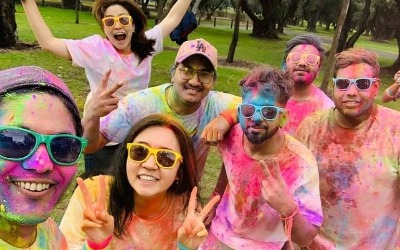 students covered with coloured powder
