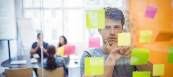 Person looking at sticky notes on window