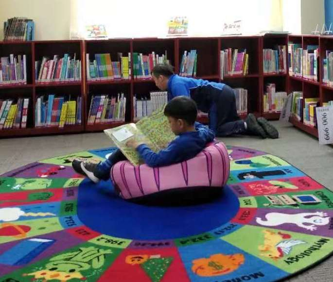 Students Reading in Primary Library