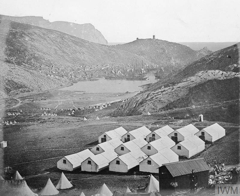 General view of Balaklava with the huts of the Guards in the foreground and shipping at anchor. Crimean War 1854-56